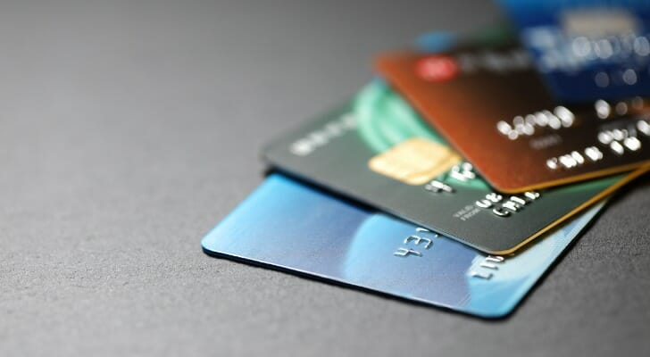 Image shows four credit cards stacked on top of one another. SmartAsset analyzed various data points to find where residents most rely on credit.