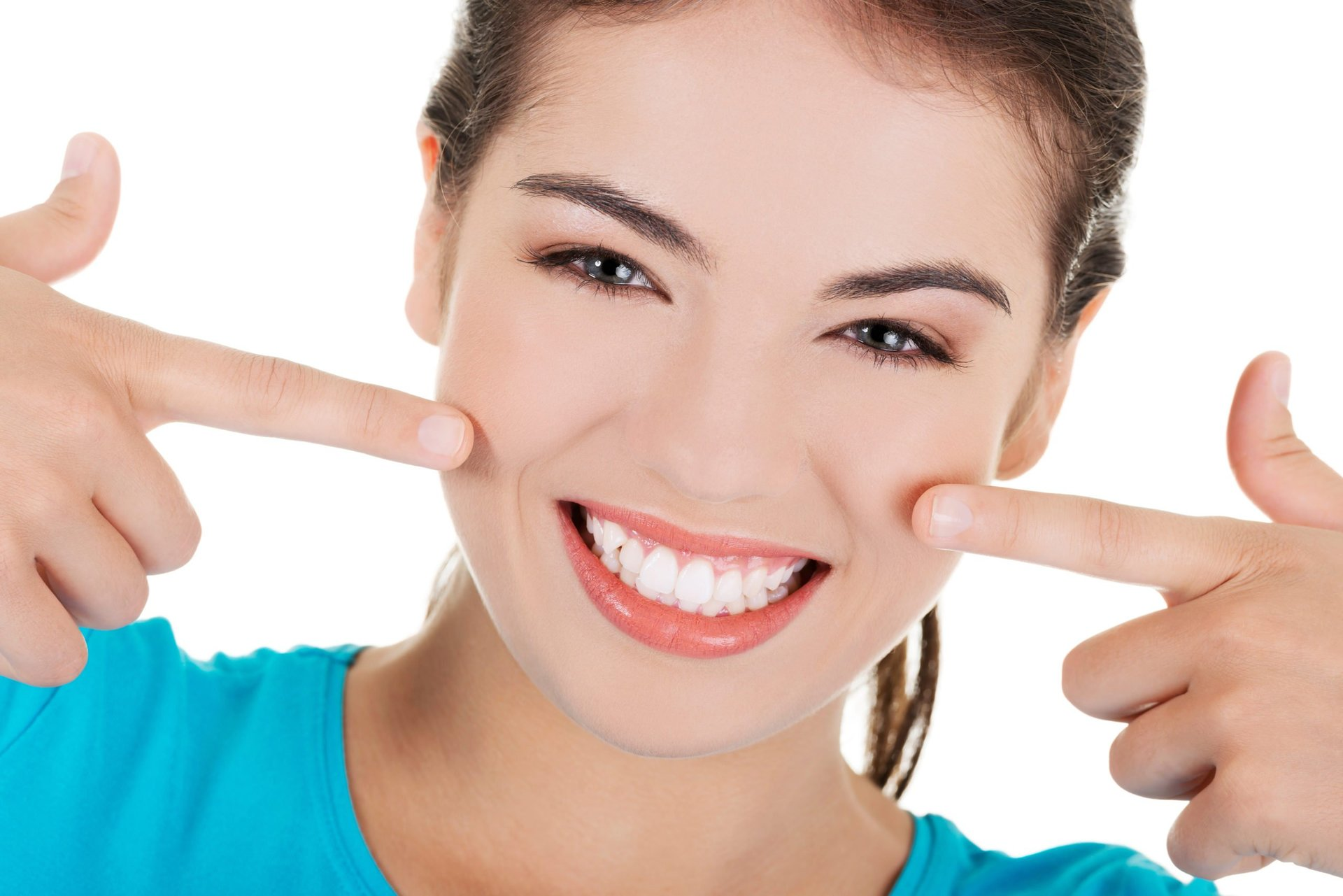 Smiling woman pointing to her teeth