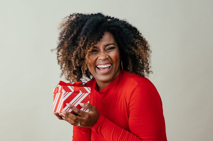 Happy woman holding a gift