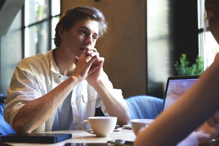 Young man concentrating on conversation.