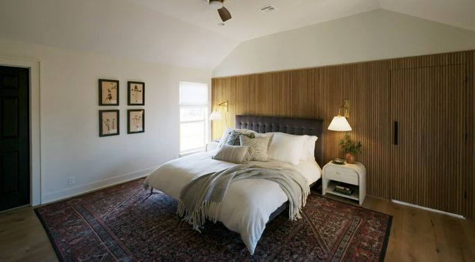 The wood paneling gives this bedroom that midcentury modern look Laney and Lucas love.