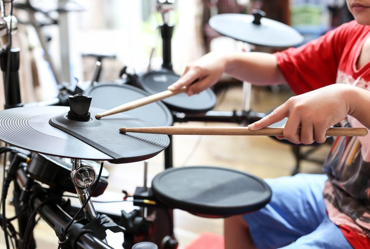 Boy playing electric drums